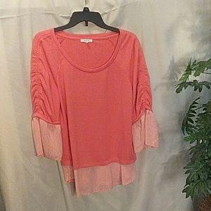 Maunces peachy color top size M